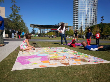 mandala on canvas in the park in the Dallas Arts District made with help from park visitors