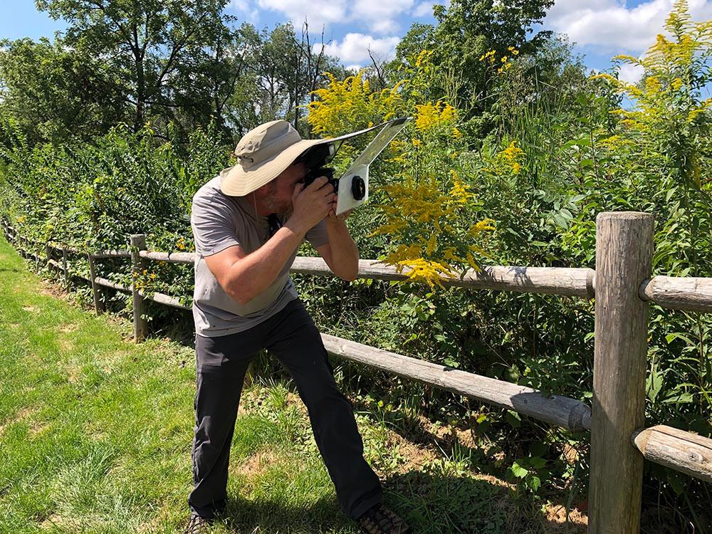 Joe Dlugo photographing bees at Belmont Prairie Nature Preserve