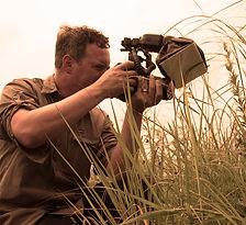 Joe Dlugo photographing bees on a tallgrass prairie
