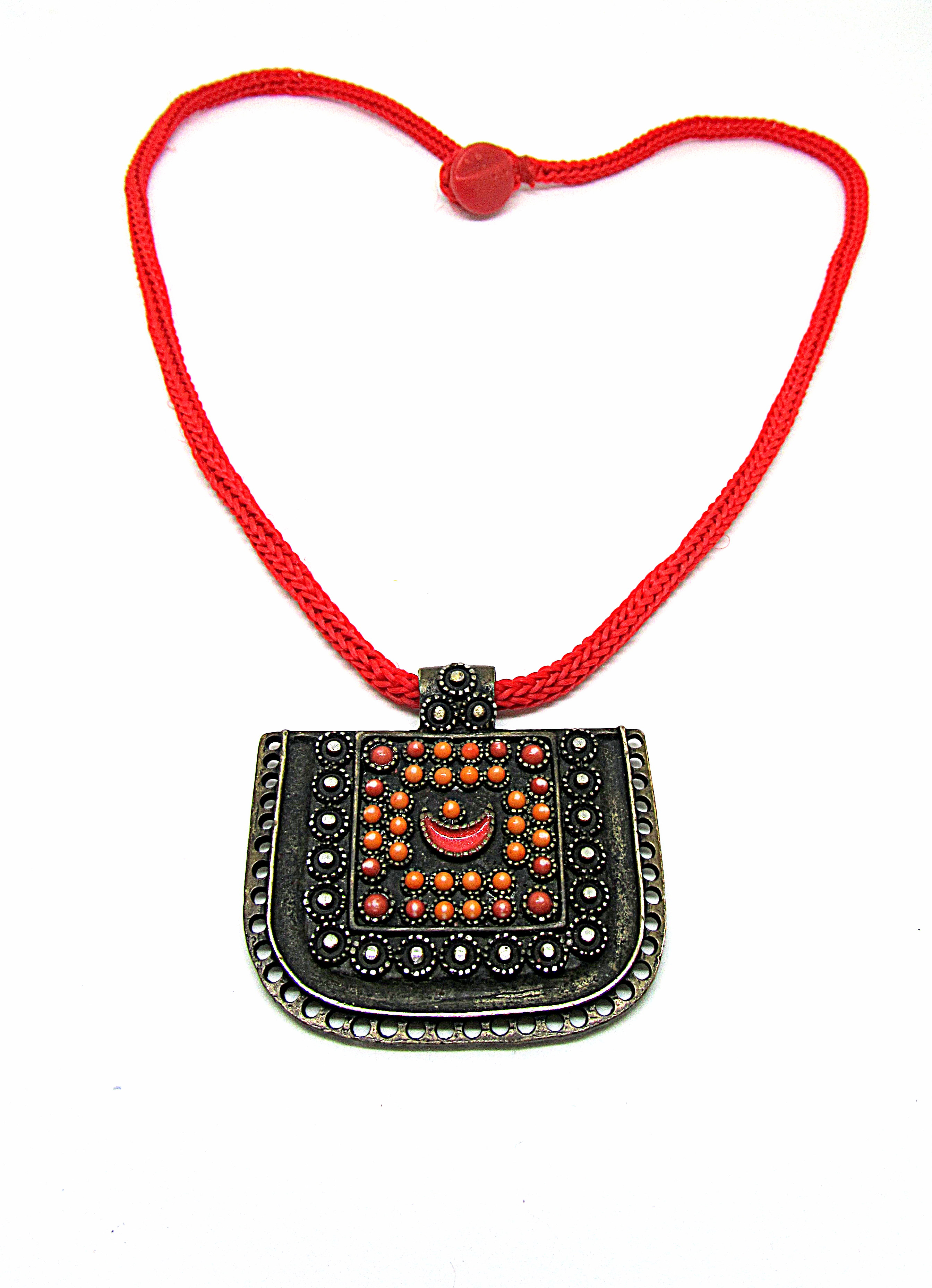 Pendant on a red lace