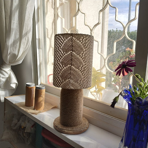Design table lamp and a lampshade made of a lace fabric in an ecological style