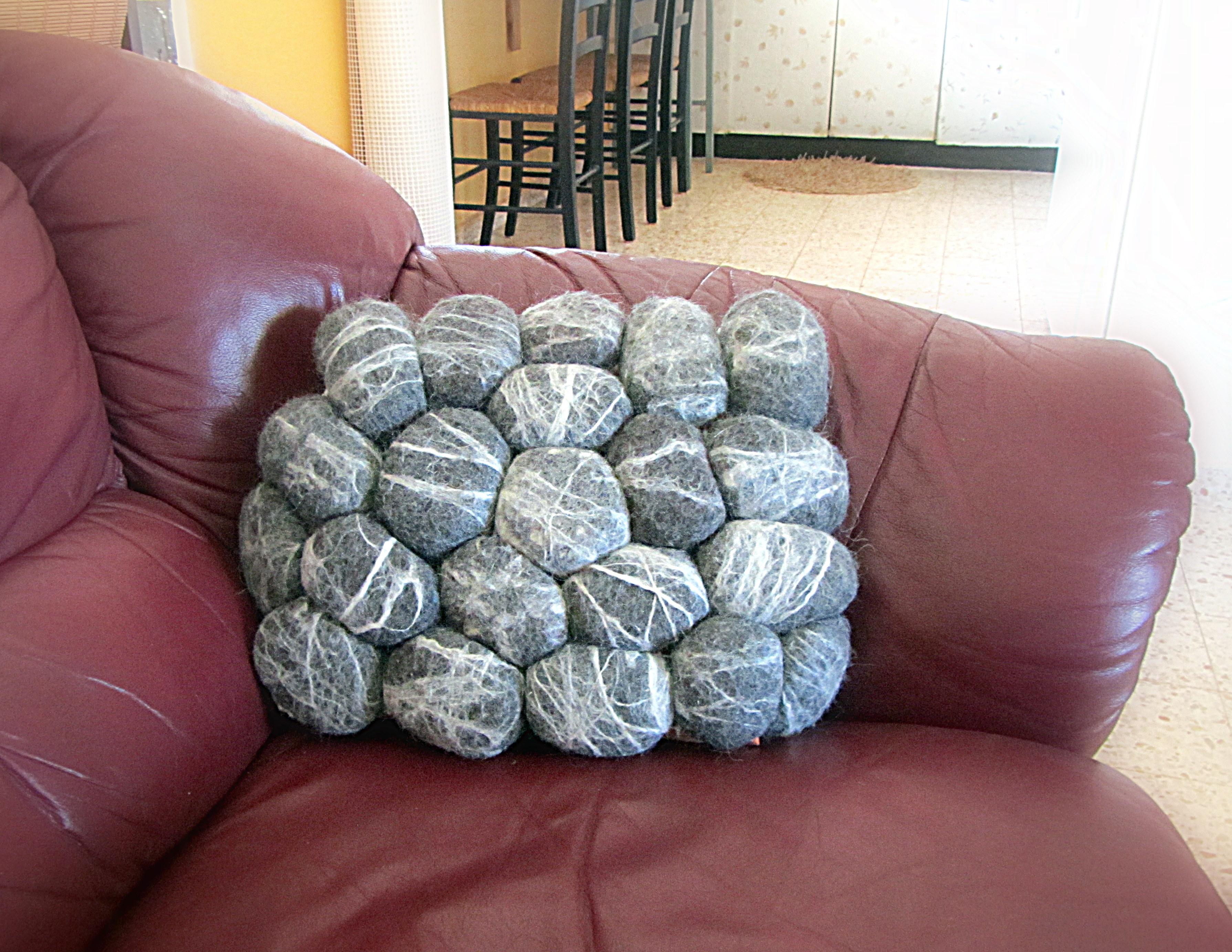 "A sofa cushion made of ""soft rocks"""