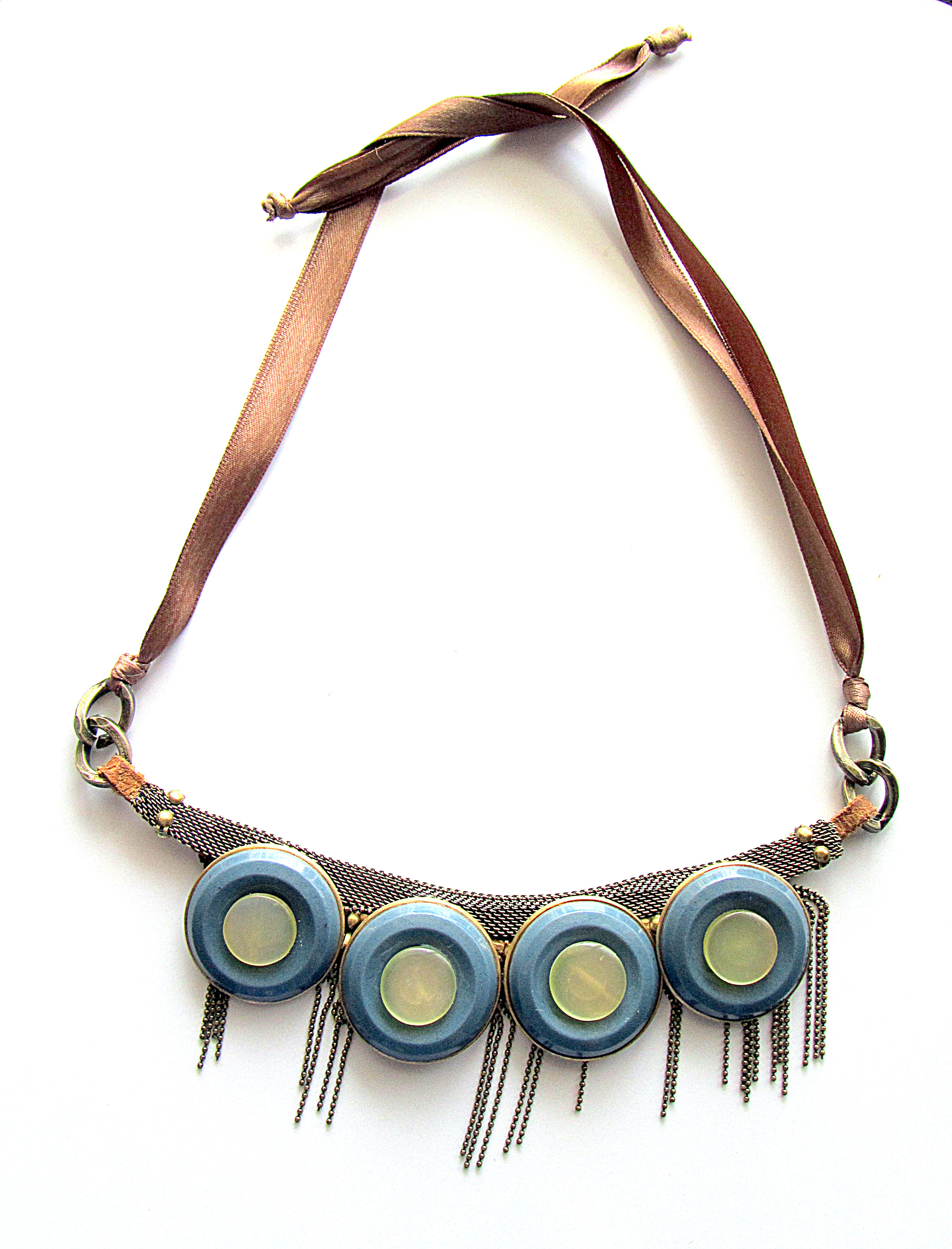 A necklace made of gray/ecru plastic