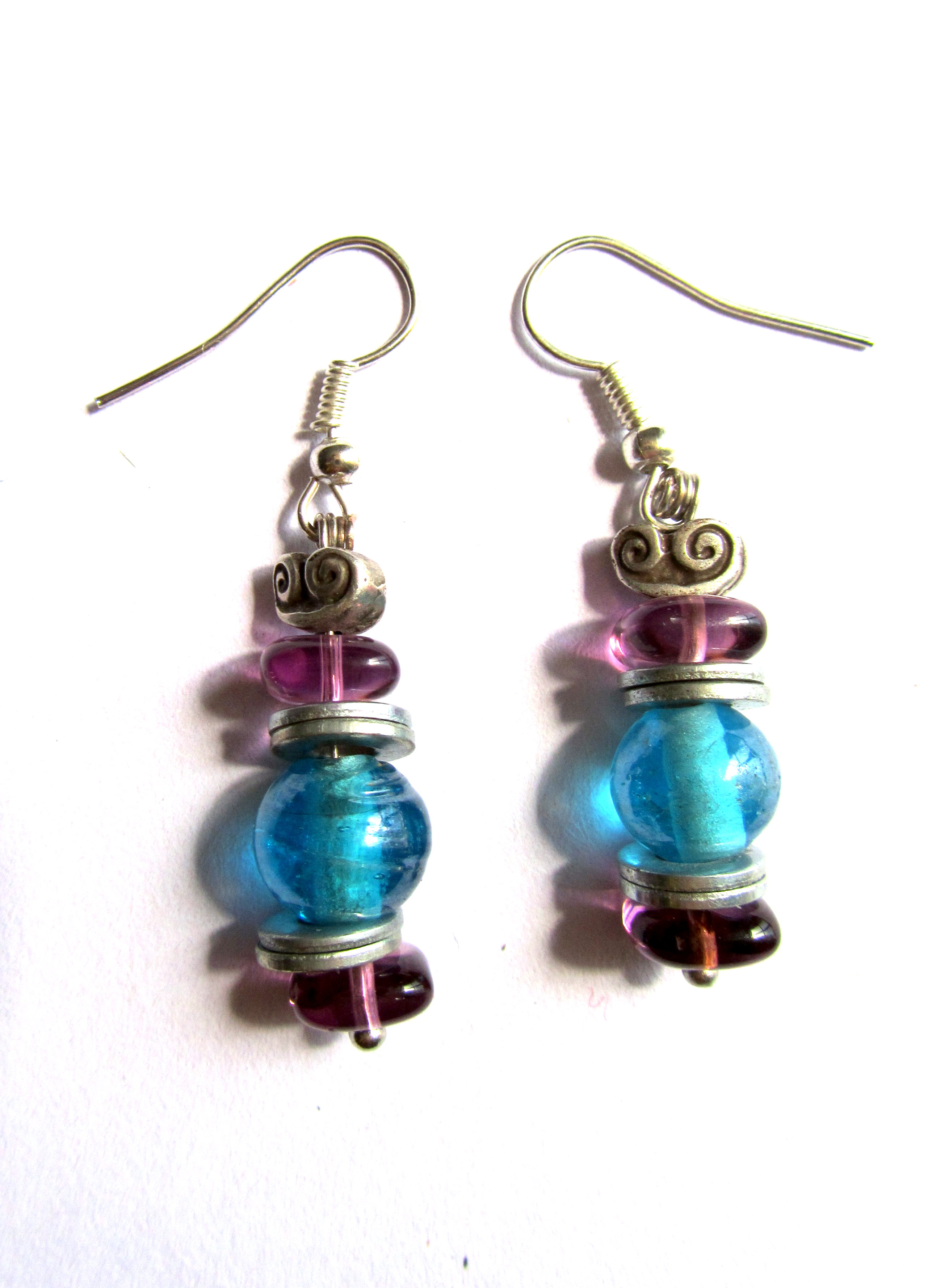 Earrings of colored glass