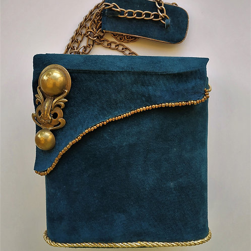 Exclusive Suede box-bag with a long handle.