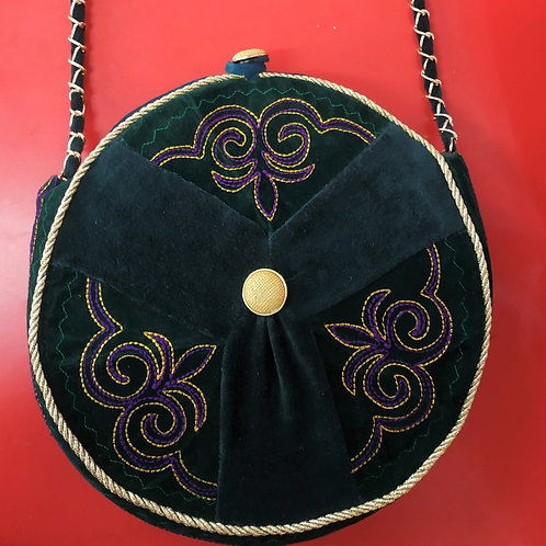 Exclusive dark green round ethno style bag witha a long handle.