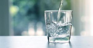 Close up pouring purified fresh drink wa
