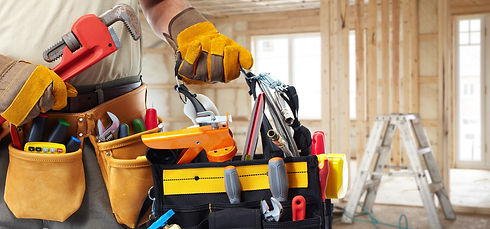 Builder handyman with construction tools. House renovation background..jpg