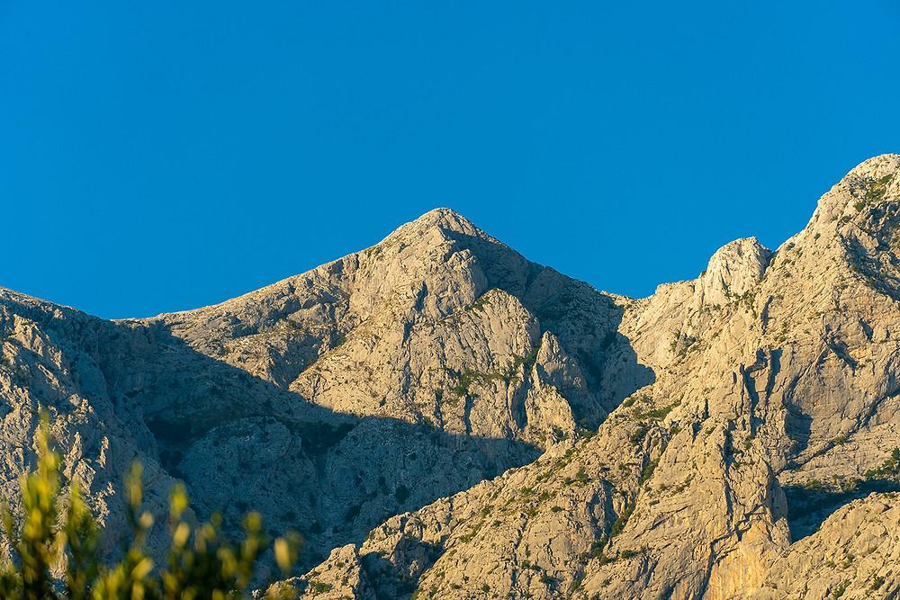 Sharp triangle mountain peak you can see when on holiday near Makarska in Croatia.