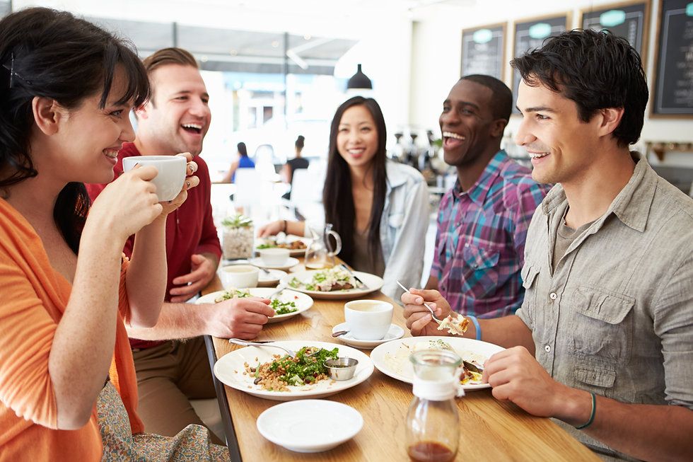 diverse friends eating together at The Cornerstone Exchange