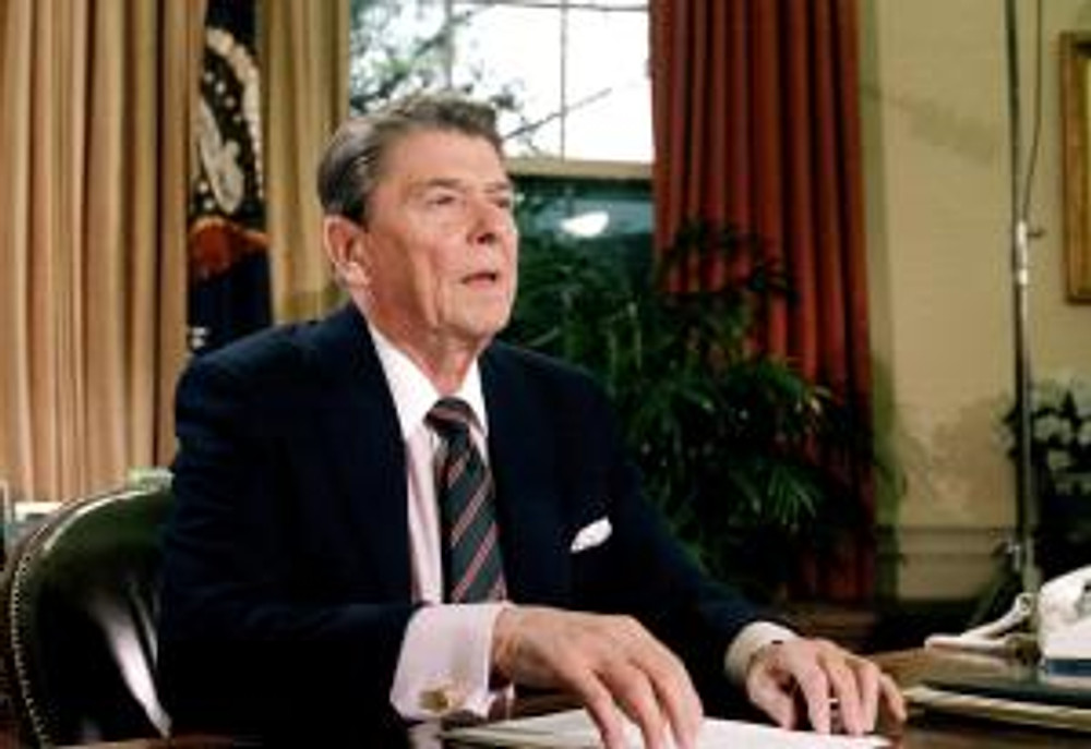U.S. President Ronald Reagan is shown in the oval office in the Whitehouse after a televised address to the nation about the shuttle challenger explosion on January 28, 1986.
