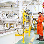 operator recording operation of oil and