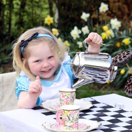 Alice poured the tea.