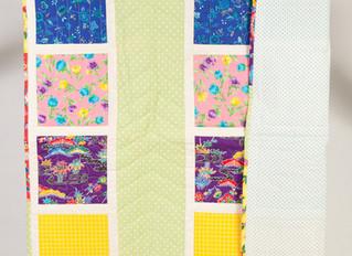 Textile Framing: Glass versus Acrylic