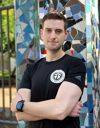 Founder of Fit First Adam Krell standing with arms crossed