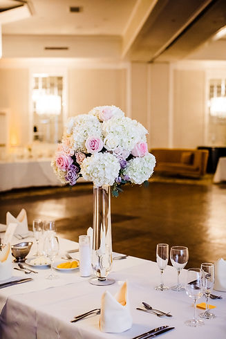 Classic wedding centerpiece in pink, lavender and white  photo credit: The Burks Photography