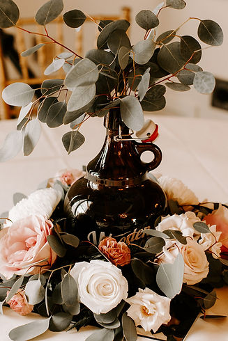 Centerpiece with beer growler at Providence Country Club   photo credit: @RobynDawnPhotos