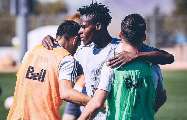 Gershon Koffie, Matias Laba, and Russell Teibert enjoy a moment following a demanding training session in Tucson, Arizona.