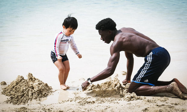 Alphonso Davies takes a pause from a recovery session in Hawaii to ... build a sandcastle.
