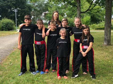 7 Pokale für Bühler Kickboxer