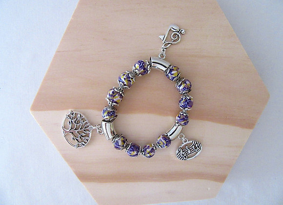 Bracelet avec trois imposants colifichets