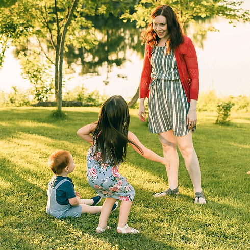 Mother and certified childbirth educator plays with her children who had very different births in Sydney, Cape Breton, Nova Scotia, Canada