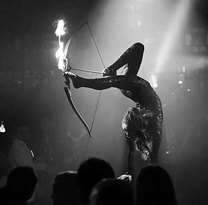 Archery, foot archery, female archery, foot archery with fire, circus acts, fire performance, handbalance act