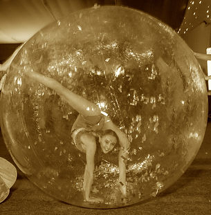 zorb ball, zorb ball in water, circus, events, contortionist, contortionist in bubble, acrobat