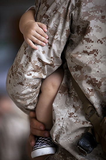 Stock photo Soldier holding baby.jpg