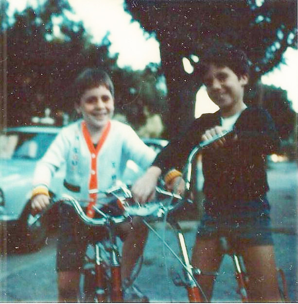 Enrique and Sebas as children biking in Buenos Aires