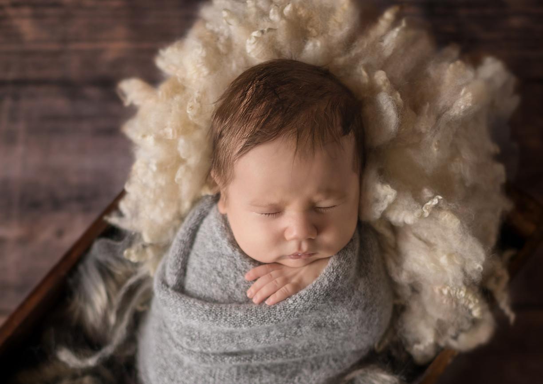 newborn-in-mid-grey-bright-eyes-photography.jpg