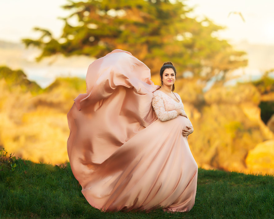 pink maternity gown at sunset