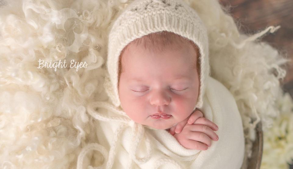 baby-girl-in-cream-wool.jpg