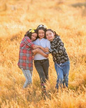 family-sisters-triplets-sunset-session.j