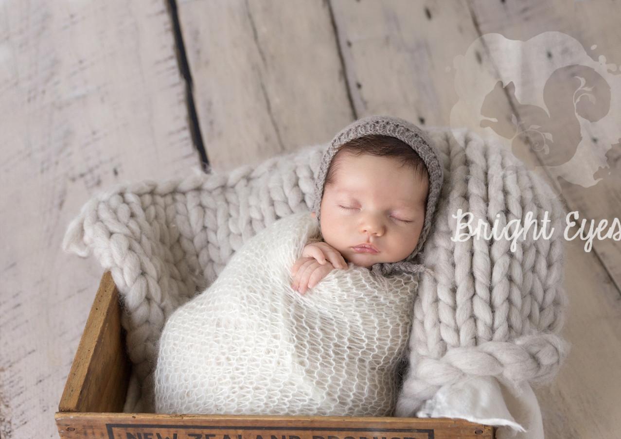newborn-in-butter-box-bright-eyes-photography.jpg