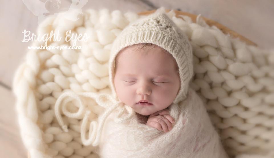 newborn-baby-in-cream-knit-basket-wool.j