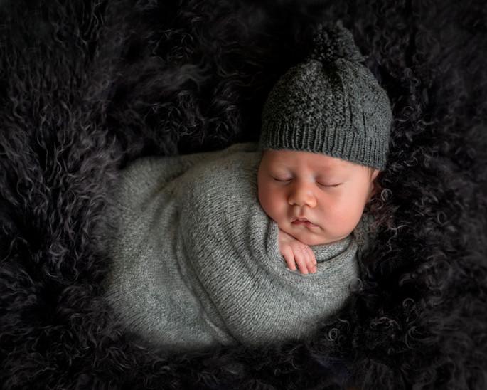 newborn-baby-in-dark-grey-beanie.jpg