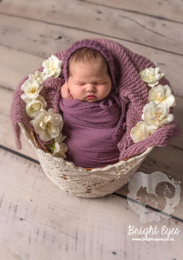 newborn-in-purple-bright-eyes-photography.jpg