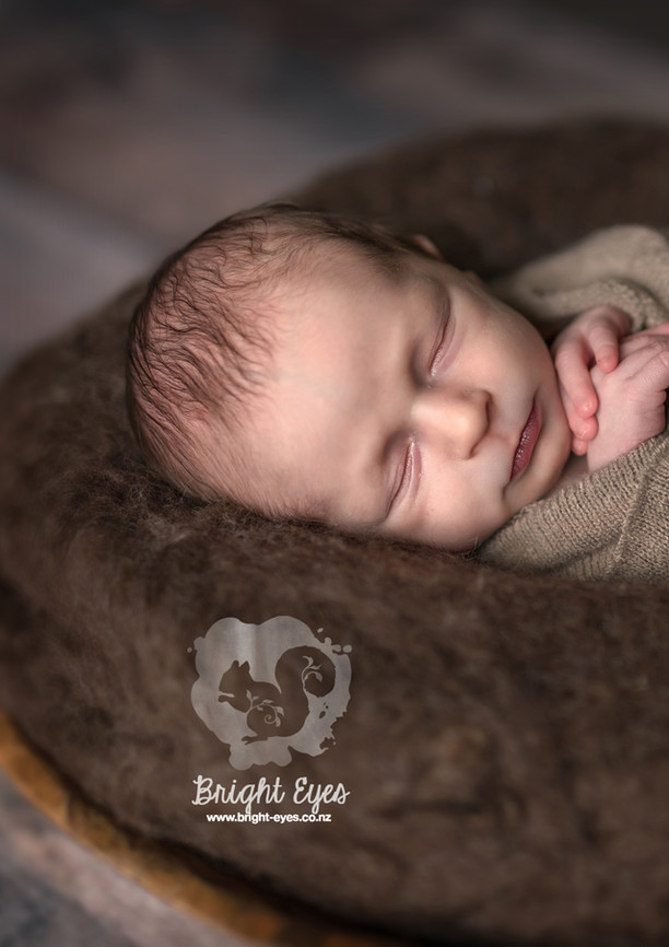 newborn-in-brown-bright-eyes-photography.jpg