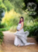 a pregnant woman poses for her maternity photos