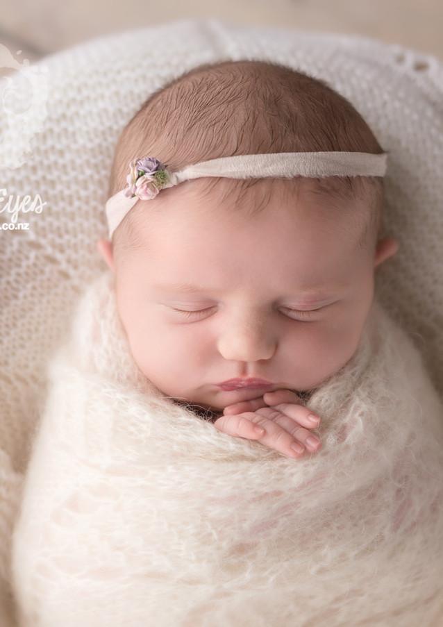 newborn-in-cream-bright-eyes-photography.jpg