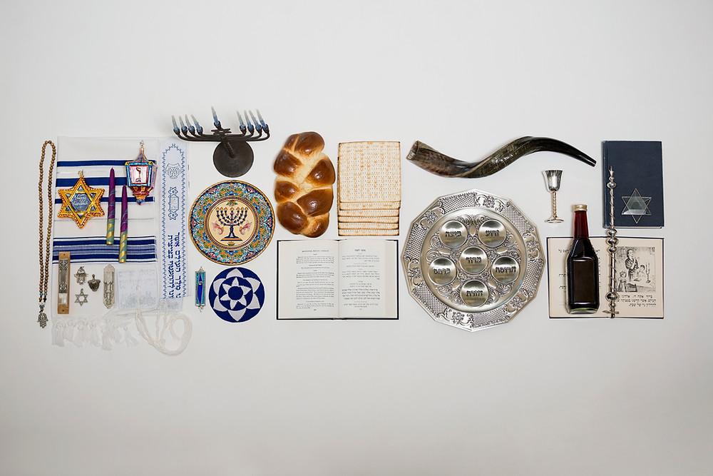 Variety of Jewish holiday symbols such as menorah, shofar, seder plate