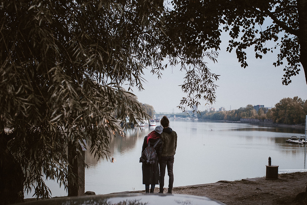 intimate couple monent at the river bank by The Wedding Fox International Wedding Photography