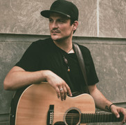 Jesse_Lopez_Holding_Martin_Guitar