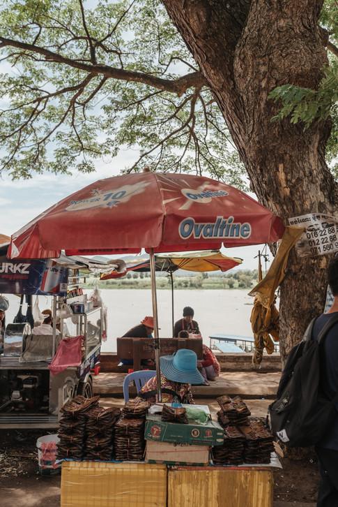 Food seller in downtown Kampong Chhnang, Cambodia