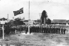 Mrs_Charles_Sharp_unfurling_the_flag_on_Anzac_Day,_25_April_1937,_Coffs_Harbour,_NSW.jpg