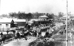 North_Coasters'_recruiting_march_started_in_Grafton_with_about_30_volunteers._View_looking_south_along_Grafton_Street_-_Coffs_Harbour,_NSW,_January_1916_(6004333854).jpg