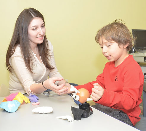 A talented speech-language therapist provides play-based speech therapy to a child at Stepping Stones Therapy in Bethesda, Maryland.