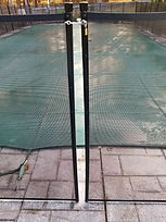 Outdoor pool with mesh pool fence installed by Pro Pool Fence, a family business providing pool fence installation in Maryland, MD, DC, VA, DE, and PA