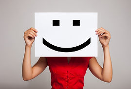Woman holding a smiling face emoticon.jp